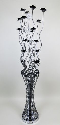 Vase Floor Lamps: tall woven wire floor lamp, with fluted vase and riveted rim. Featuring  bloomed black flowers, and crystal encrusted shades,Lighting