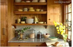 Granite counters and gray-green glass tile. These red birch cabinets look warm and rich against a grayish-green glass tile backsplash and granite counters with gray tones. Try this classic look with midtone wood cabinets, like honey-toned oak or cherry.  http://www.houzz.com/ideabooks/29908661/list/what-goes-with-wood-cabinets
