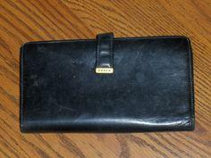http://www.bonanza.com/listings/Coach-Black-Leather-Clutch-Wallet-Check-Book-Holder/41521084