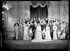 Photo by Bassano Ltd on 20 Nov 1947 of the Royal Wedding Party of future Queen Elizabeth II (Elizabeth Alexandra Mary) (21 Apr 1926-living2016 age 90) UK & Prince Philip Mountbatten (10 Jun 1921-living2016 age 95) Greece in the Throne Room, Buckingham Palace, London, UK. Located 2016 UK National Portrait Collection NPG x158912.