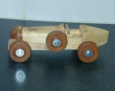 Hand made traditional wooden toy car on the style of the 1930 Bugatti. A limited edition 1 of 100 made in pine and mahogany.