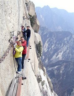 Image: Tourists navigate a narrow walkway on a scenic mountain in Shaanxi Province, China, on May 29 (© HAP/Quirky China News/Rex Features)
