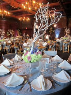 This centerpiece is whimsical and talk enough that people can see each other across the table.