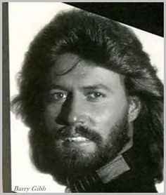 Barry Gibb. Ruggedly handsome. Who would believe the falsetto parts of the Bee Gees songs were sung by him??