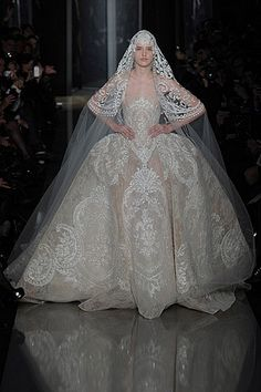 Ellie Saab Wedding. Not my type of gown but there's something about it I like...