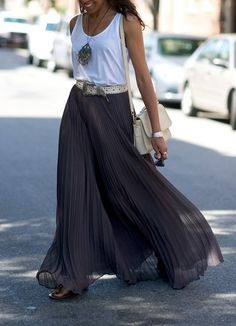 Grey pleated maxi skirt with a white tank top and big necklace.