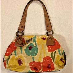 Fossil purse Colorful Fossil Fabric & Leather Shoulder Handbag! Prelovedthe inside is fabric & there is tiny hole on the seam! Fossil Bags