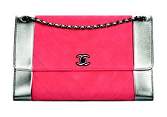 CHANEL Red and silver leather handbag with chain strap, price upon request; available at Chanel boutique