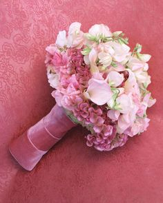 Velvet Bouquet Wrap    To make an autumn or winter bouquet even more lush, include cockscomb -- the deep-pink ruffle-edged flower here -- and then highlight its rich texture with a thick velvet-ribbon bouquet wrap. This example also contains calla lilies and sweet pea.