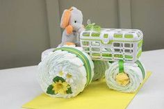 Diaper tractor! Made of 30 diapers, a washcloth, stuffed animal, a pacifer, and a dishwasher basket-which can be traded out with a box of wet wipes