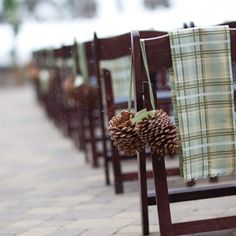 My winter wedding made TheKnot.com! As you can see, the ceremony was outdoors with light snow falling. We accented the chairs along the aisles with a sage green and ice blue plaid (our colors) due to the wedding being both on St. Patrick's Day and to match our rustic theme. Pinecones were a must-have accent in Tahoe.