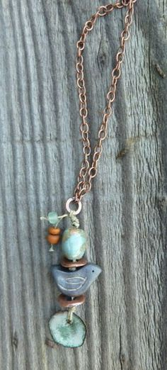 The Bird Blues Charcoal Grey Ceramic Bird with Enameled Copper Charm and Ceramic Bead on Copper Chain. $36.00, via Etsy.