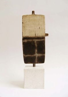 Jay Kelly;  2009, Metal, Wood, Gesso.    6 x 2.75 x .25 inches, Wood base  2 x 2 x 2 inches