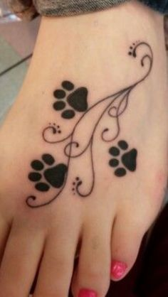 15 Coolest & Unusual Paw Print Tattoo Designs - Paw print tattoo designs are very common among animal lovers and makes a symbolic gesture.