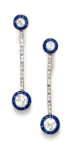A PAIR OF ART DECO SAPPHIRE AND DIAMOND EAR PENDANTS, BY TIFFANY & CO.  Each suspending an old European-cut diamond within a calibré-cut sapphire surround, to the single-cut diamond line, to a surmount of similiar design, mounted in platinum, circa 1925 Signed Tiffany & Co.