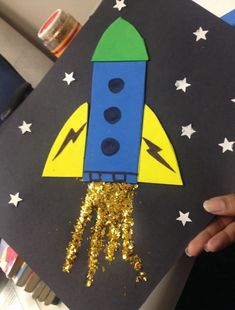 Rocket ship with glitter fire in space! A craft I made for our Storytime kids at the library . Great for primary age children, even preschool! Helps with shapes and motor skills. I used foam sheets for the rocket and star hole puncher for the space atmosp Vbs Crafts, Daycare Crafts, Toddler Crafts, Preschool Crafts, Crafts For Kids, Arts And Crafts, Space Preschool, Space Activities, Preschool Activities
