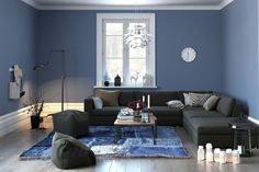 interior of a modern lounge or living room in grey and blue decor with a comfortable couch and pouffe and single central window. Home Interior, Modern Interior, Decor Interior Design, Interior Decorating, Blue Painted Walls, Blue Walls, Dark Grey Couches, Paint Shades, Mediterranean Homes