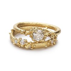 Unique Ruth Tomlinson alternative wedding band or stacking ring featuring white diamonds set amongst granules of yellow gold, handmade in our London studio.
