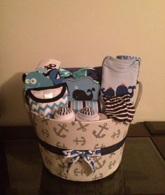 Your little sailor will be sailing the seas! Includes: 4 receiving blankets, 45 Huggies size 1 diapers, a pair of baby mittens, 6 baby washcloths, sailboat themed footed pajama sleeper (size month Baby Shower Diapers, Baby Shower Cakes, Baby Boy Shower, Baby Shower Gifts, Baby Showers, Baby Boy Gift Baskets, Baby Boy Gifts, Diaper Cake Boy, Diaper Cakes