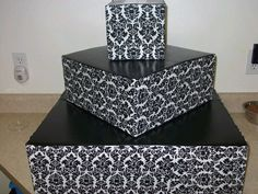 DIY cupcake stand out of cardboard boxes, fabric and spray paint