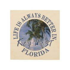 Funny Life Is Always Better In Key West  Beach RND Wood Print Life is always better in Key West - the beach, relaxed lifestyle, the parties and Duval street! This tropical souvenir logo style design features landscape nature travel photography of a gorgeous beach with a blue sky in the background and palm trees in the foreground. This photo was taken in Key West, Florida USA. Great gift for a beach lover.