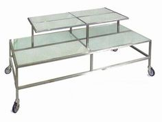 Two Tier Table With Frosted Glass Shelves And Heavy Duty Casters With  Brakes. Top Is