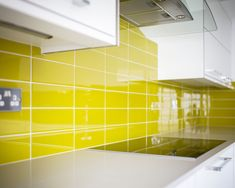 Large Format Yellow Glass Tiles - Acid Yellow Boom! by Alec Buchan. Stunning, bright and vibrant tile to make every day like summer.