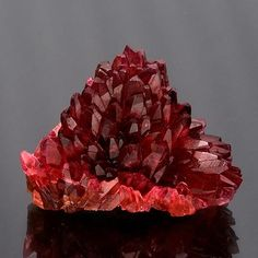 Rhodochrosite :: Spectacular rhodochrosite cluster with orangy red scalehedron crystals in a radiating pineapple formation. Size: x x cm Country: South Africa. My Favorite stone