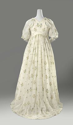 Dress (back view): ca. 1800-1810, Dutch, embroidery done in India, loosely woven cotton, decorated with floral motif embroidered in multicoloured silk.