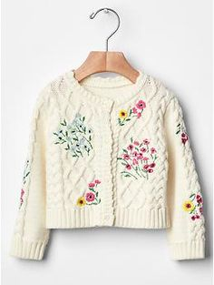 Floral cable knit cardigan.