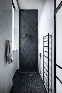 For an industrial, cool wet room, tactile tadelakt and lava stone tiles work well to create a space that's both efficient and indulgent. #wetroom #bathroominspo #tadelakt #Bathroomdesign
