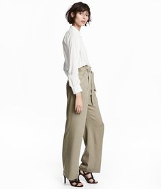 Trousers in a Tencel® lyocell weave with a high paper-bag waist and tie belt. Zip fly, side pockets, welt back pockets and straight, wide legs. Pants Outfit, Kids Fashion, Autumn Fashion, Women's Fashion, Capsule Outfits, Capsule Clothing, Layering Outfits, Work Outfits, Legs