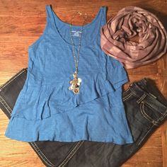 """DKNY tiered blue tank NWOT New DKNY blue layered/tiered tank top. Long and loose-fitting. Measures 19.5 inches from under arm to bottom of tank. Measures 21"""" across chest from side seam to side seam under arm. 100% cotton. New without tags. DKNY Tops Tank Tops"""