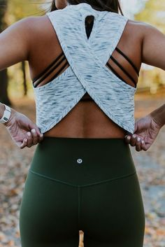 workout outfit. wrap back top. strappy bra.