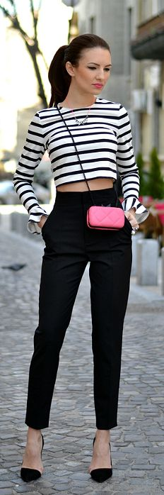 #datewear | a black & white striped crop top paired with black crop trousers & matching pumps styled with a hot pink cross-body clutch