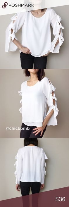 """Rebecca ribbons sleeve blouse top White long sleeve blouse. Ethereal white with ribbon tied sleeves. Double layer front . Casual chic.             MADE IN USA 100%polyblend.                                                                        Size S -B:33"""" L:23"""".                                                         Size M- B:34"""" L:23""""                                                         Size L- B: 36"""" L:24"""" CHICBOMB Tops Blouses"""