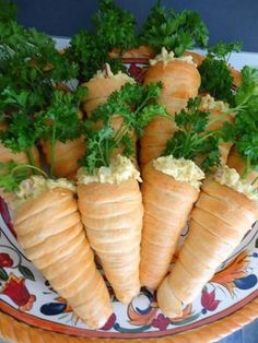 Check out this cute idea to serve egg salad (or whatever)...form your crescents like a cone and bake...then stuff with egg salad and top off with parsley...they look like carrots!