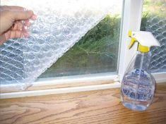 Spray the window, wet with water and slice the bubble wrap to the window. The bubble side must bear against the window. This trick really works and can save quite a lot of energy!