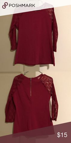 Maroon 3/4 Laced Sleeved Top Maroon with maroon lace 3/4 sleeves. Zipper in back. Stretchy. Body is 95% Cotton, 5% Spandex. Sleeves are 90% Nylon, 10% Spandex. Express Tops Blouses