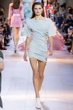 He went for high contrast, whether it was in a sweeping ruffled cut-away ballskirt paired with a t-shirt or the minidress tied along one side that followed. Denim was mixed with lamés, jeans with dressy bandeaus featuring demonstrative big bows.    - HarpersBAZAAR.com