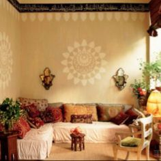 scatter cussion, manala wall art and plants make for a boho feel #bohowonderchild #bohohome