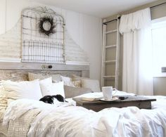 Thrifty finds bedroom makeover by @Donna - Funky Junk Interiors. The ladder and messy bed are my favorites:)
