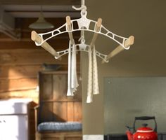 The pulley maid deluxe ceiling clothes airer drying rack hanging in a traditional country kitchen setting. The rack ends are white and the wooden laths pas through them as the washing is hung to dry in the laundry utility room. Drying Rack Laundry, Laundry Dryer, Clothes Drying Racks, Laundry Closet, Clothes Hanger, Clothes Dryer, Small Laundry, Laundry Rooms, Laundry Hanger