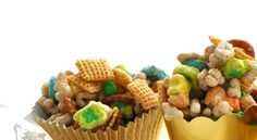 MAGICALLY DELICIOUS:  4 C Lucky Charms   2 C Corn Chex   1 1/2 C broken pretzels  1 C dry roasted peanuts  1/2 C brown sugar  1/4 C butter  2 T corn syrup  1/8 t b soda  1/4 C mini green M&Ms/  Mix cereals, pretzels and peanuts; set aside. Heat brown sugar, butter and corn syrup until melted. Add baking soda. Pour over cereal, stir.  Heat and stir until cereal begins to brown. Cool 5 min; add candies. Spread on waxed paper to cool; break into bite-size pieces.