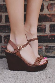 Our Resort Romance Wedge will make walking alongside your honey on the beach a whole lot cuter! A pair of faux leather straps wedges featuring a scalloped cutout design, buckle ankle strap and faux wo