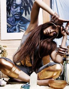 there are so many things that I like about this photo, not the least of which is the painting in the background. #ErykahBadu
