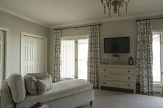 photo by Med Dement  #bedroom #calm #serene #calmbedroom #chaise #chaiselounge #plush #chandelier #tv #curtains #chattanooga #cha
