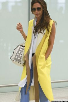 If you're brunette, here the perfect color for you! victoria beckham with a yellow long sleveless jacket