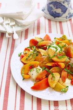 Heirloom tomato, peaches, basil and burrata salad from House Beautiful