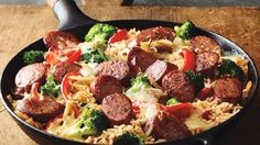 """Dinner's on the table in no time with this one-skillet sausage and veggie dish served over ounce) package Hillshire Farm® Smoked Sausage, diagonally cut into slicesHeat olive … Sausage Skillet Recipe, Smoked Sausage Recipes, Sausage Rice, One Skillet Meals, Pork Recipes, Cooking Recipes, Recipies, Yummy Recipes, Sausage Casserole"
